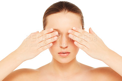 Buy stock photo A young woman covering her eyes