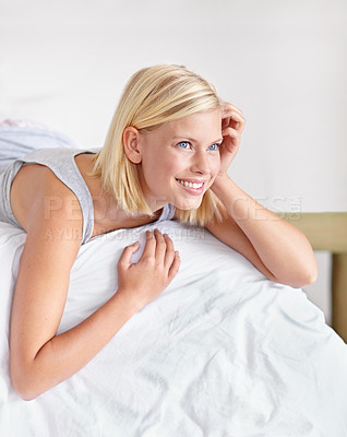Buy stock photo An attractive young woman lying on her bed and anticipating the day ahead