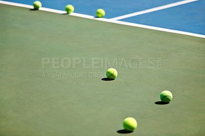 Buy stock photo A cropped image of tennis balls lying on the court
