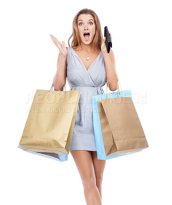 Buy stock photo A beautiful young woman looking surprised while shopping