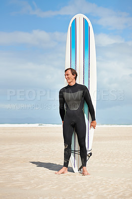 Buy stock photo full length shot of a surfer standing on the beach with his surfboard