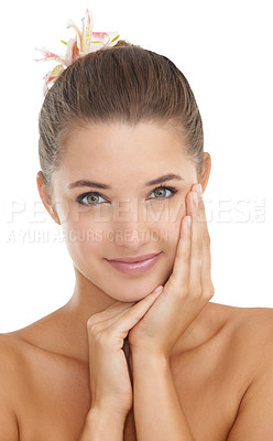Buy stock photo Portrait of an attractive young woman happily touching her face