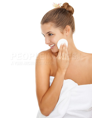 Buy stock photo A beautiful young woman wiping her cheeks with a cotton swab