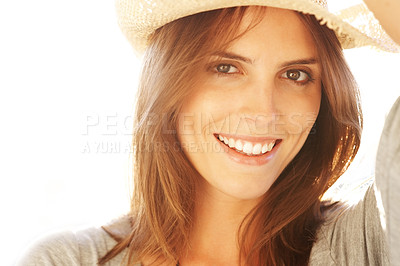 Buy stock photo Smiling young woman wearing a straw hat