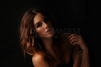 Buy stock photo Portrait of an attractive young woman in the dark