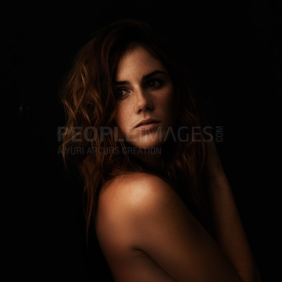 Buy stock photo A gorgeous young woman looking over her bare shoulder against a white background