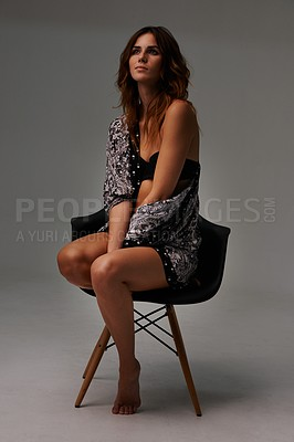 Buy stock photo Beautiful young woman sitting on a chair while in her lingerie