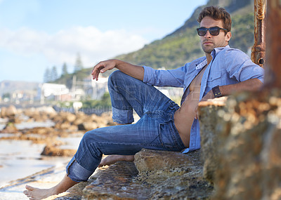 Buy stock photo A young man relaxing at the beach
