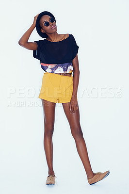 Buy stock photo Full-length shot of an African American hipster wearing sunglasses while posing in studio