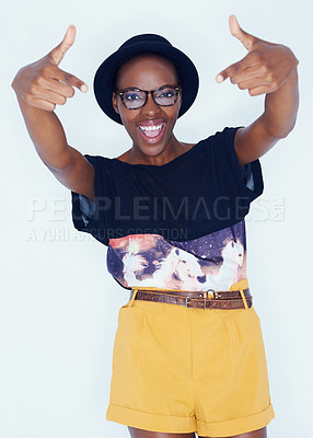 Buy stock photo A pretty and stylish african american woman posing for a studio shoot