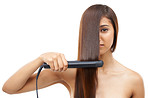 Straightening her hair for a great date