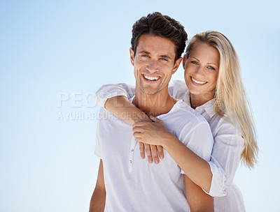 Buy stock photo A young couple looking at the camera
