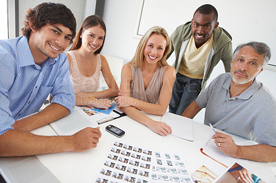 Buy stock photo A diverse group of business colleagues working on a project together in the boardroom