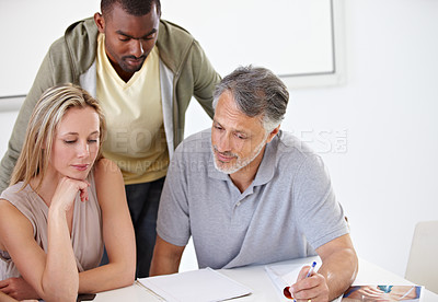 Buy stock photo A group of designers having a discussion in their office