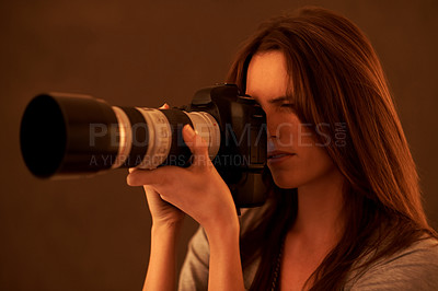 Buy stock photo Young beautiful woman taking a photo with a camera