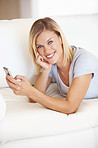 Woman text messaging on couch