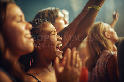 Buy stock photo Young girls in an audience enjoying their favourite band's performance