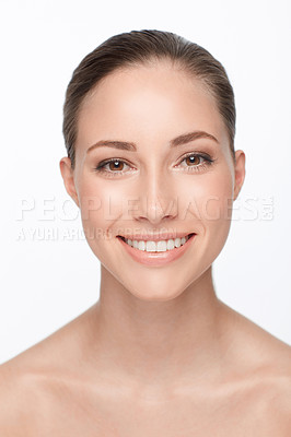 Buy stock photo Head and shoulders portrait of a beautiful smiling woman