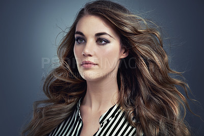 Buy stock photo An attractive and fashionable young woman in studio