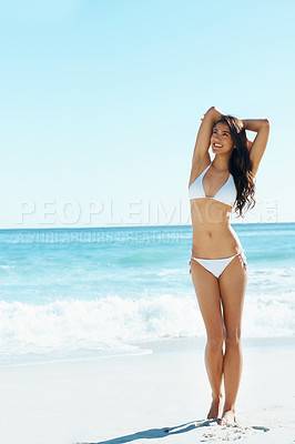 Buy stock photo Full length shot of a gorgeous young woman wearing a bikini on the beach