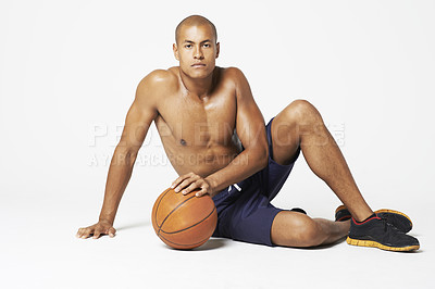 Buy stock photo Studio shot of a handsome young basketball player