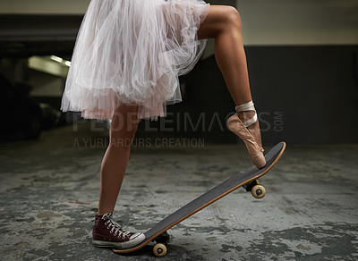 Buy stock photo A cropped image of a woman on a skateboard wearing one sneakers and a ballet slipper