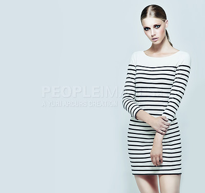 Buy stock photo Studio shot of a stylish model with her hands on her hips