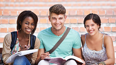 Buy stock photo Portrait of three smiling students on the steps of their college campus