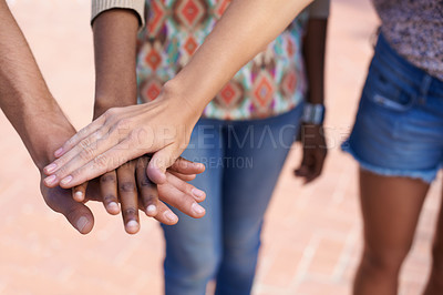 Buy stock photo Cropped image of young people's hands on top of each other