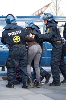 Buy stock photo Policement arresting a suspect