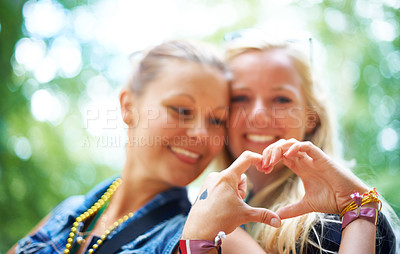 Buy stock photo Two friends having fun at a festival