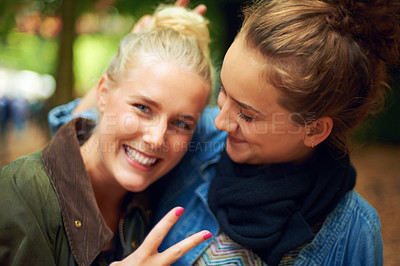 Buy stock photo Shot of two young women having a good time at an outdoor festival
