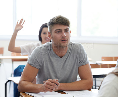 Buy stock photo Shot of a university students studying in class