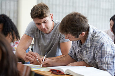 Buy stock photo Shot of young college student studying