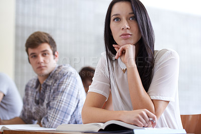Buy stock photo Shot of a young college student studying in class