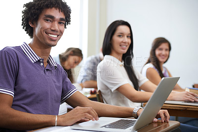 Buy stock photo Portrait of a group of smiling university students working on laptops in class