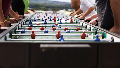 Buy stock photo Cropped shot of a group of people playing foosball