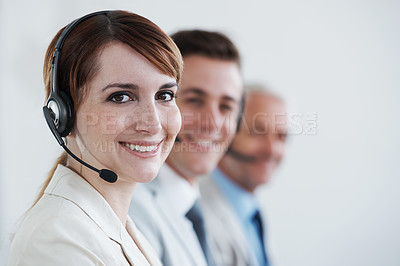 Buy stock photo Shot of a beautiful young customer service agent working in an office