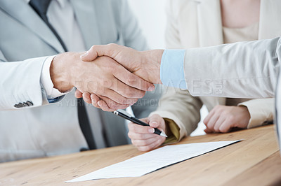 Buy stock photo Shot of a business man shaking hands with another business man