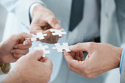 Buy stock photo A business concept image of puzzle pieces fitting together - closeup