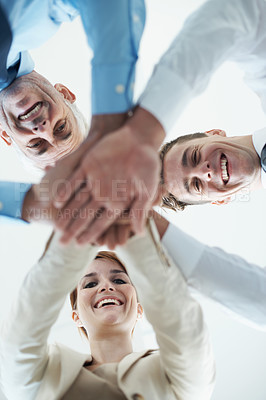 Buy stock photo Portrait of a group of business people standing in a huddle