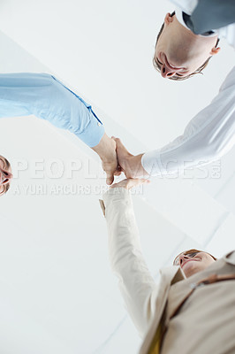 Buy stock photo Shot of a group of business people doing a high five