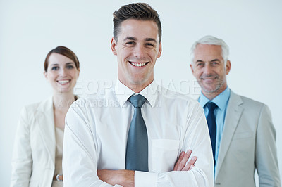 Buy stock photo Shot of a three corporate coworkers in an office