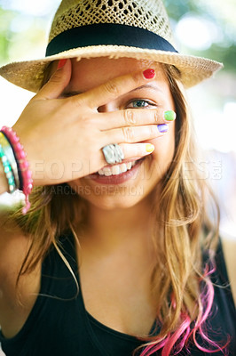 Buy stock photo A young woman wearing multi-coloured nail polish