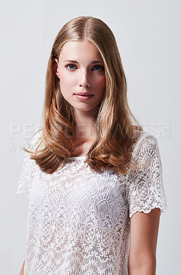 Buy stock photo Studio portrait of a pretty blonde woman against a gray background