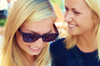 Buy stock photo Shot of two friends enjoying themselves at an outdoor festival