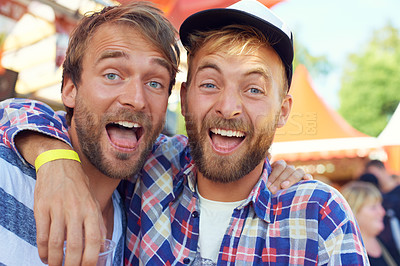 Buy stock photo Shot of two guys partying at an outdoor festival
