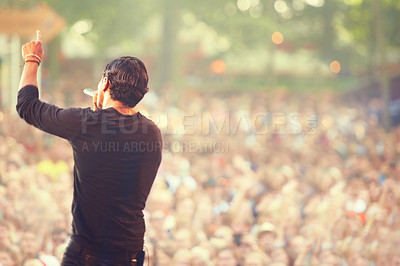 Buy stock photo Cropped shot of fans at an outdoor music concert