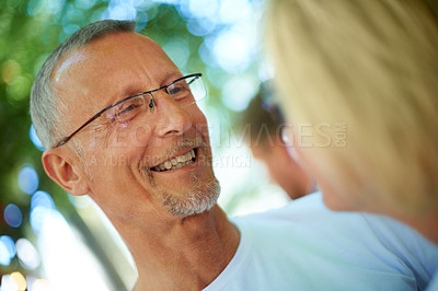 Buy stock photo Shot of a mature man looking lovingly at his wife