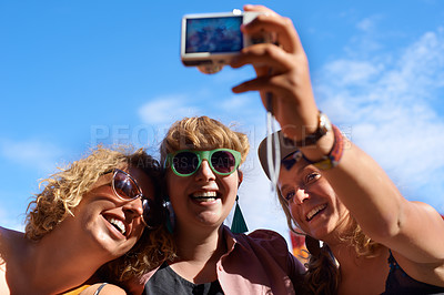 Buy stock photo A group of friends taking a self portrait while at an outdoor festival